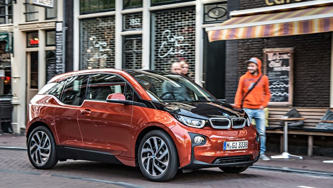 The BMW i3 features a carbon fiber structure and center-opening doors. Its light weight enables a 100-mile range and 0-60 mph in 7 seconds. Recharging takes 3 hours (80 percent in 20 minutes).