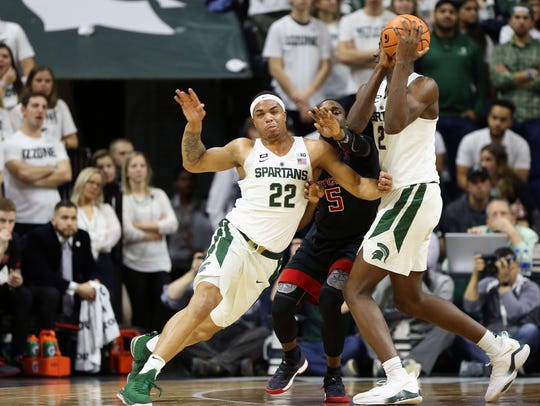 Michigan State Spartans guard Miles Bridges (22) fights
