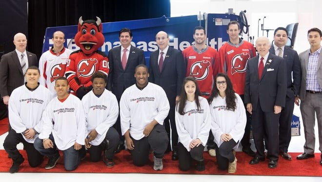 Members of the New Jersey Devils and Barnabas Health came together Wednesday to announce a healthy living initiative for youth hockey players in New Jersey like the one seen in the front row.