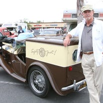 Phil Hammel stands with his 1946 MG TC Roadster Delivery at the Donut Derelicts car show in Huntington Beach, Calif.