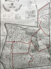 A map delineates Belleville's existing elementary school borders.