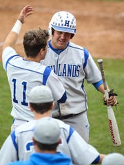 Brady Murray welcomes Todd Ramey back to the dugout after he scored an insurance run in the seventh inning of Highlands' 5-2 win over McCracken County in the state baseball championships Tuesday, June 2.