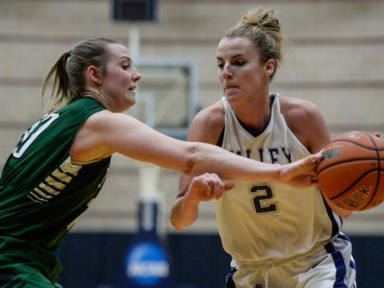 Stevenson's Sara Tarbert, left, knocks the ball away from Hilary Yoh as Stevenson University defeated Lebanon Valley College, 61-58, in January.