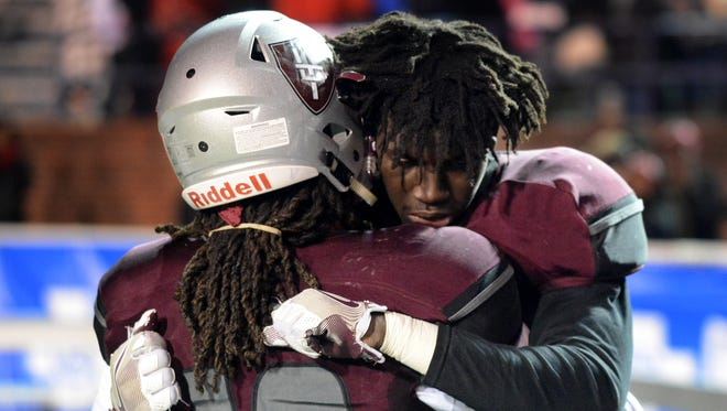 Liberty Tech's Corey Newble and Walker Russell hug at the conclusion of their 2016 TSSAA Class AAA Championship game against Alcoa. Liberty fell to Alcoa, 45-12.