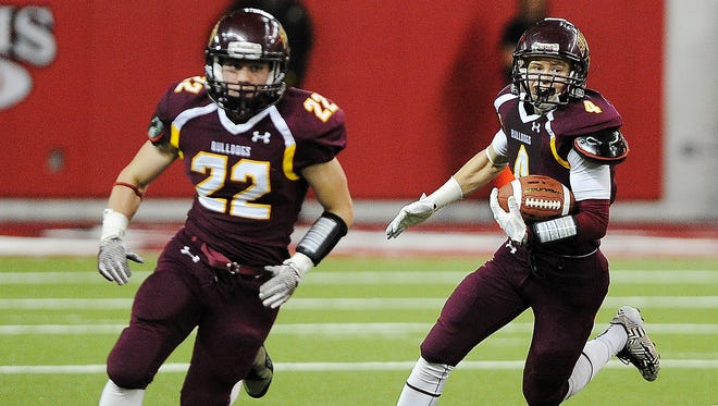 Madison's Mason Leighton (4) caught five passes for 169 yards and three touchdowns in the Class 11A championship game.