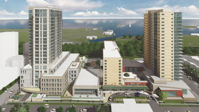 St. John's on the Lake plans to develop a 22-story tower (left). It would join a senior housing community that already includes a 10-story building (middle) and a 21-story tower (right) on Milwaukee's east side.
