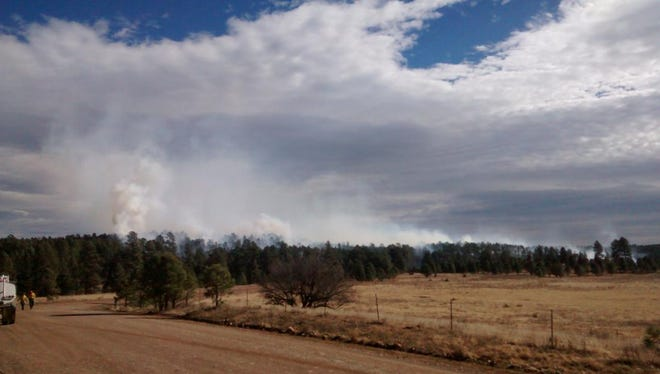 Fire fighters approach a wind-driven wildfire early Wednesday in the Whitetail region of the Mescalero Apache Reservation.