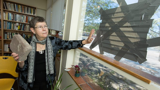 "Unitarian Universalist Church of Las Cruces minister Suzanne Redfern-Campbell holds a rock on Friday, March 25, 2016, that someone used to break a window in her office at the church on March 4, 2016, which was one of two windows broken that day. Vandalism began at the church in December after the they installed ""Black Lives Matter,"" signs around the property, many of which have been stolen. On January 18, Martin Luther King, Jr. Day, six windows on the church property were broken and signs were stolen."