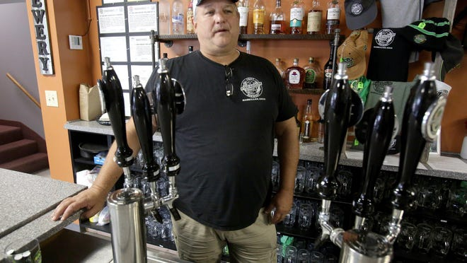 Mike Malinowski, owner of Paradigm Shift Brewery in Massillon, talks Thursday afternoon about the idea of a Designated Outdoor Refreshment Area (DORA) for the city's downtown. Malinowski has talked to City Councilwoman Linda Litman, D-Ward 6, about establishing a DORA.