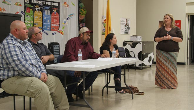 Jefferson Montessori Academy principal Stacey Frakes (far right) addresses candidates for the school's Council of Trustees Sept. 20, 2016. Robert Johnson (far left), who was elected in September 2016, resigned from his position last month.