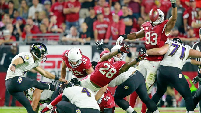 Arizona Cardinals' Justin Bethel (28) and Frostee Rucker (93) attempt to block a kick by the Baltimore Ravens' Justin Tucker in the first half on Oct. 26, 2015 in Glendale.