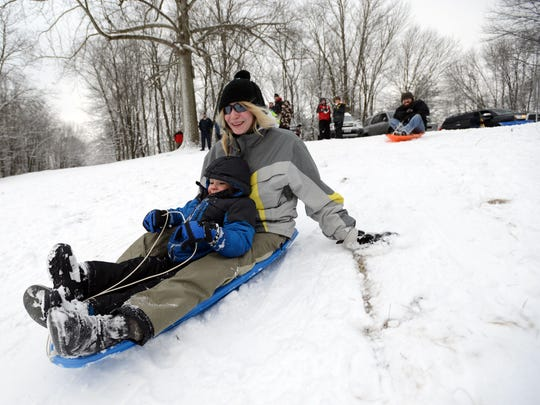 Amanda Kowalski and her son, Levi Markey, 4, start down the sled hill at Dillon State Park.