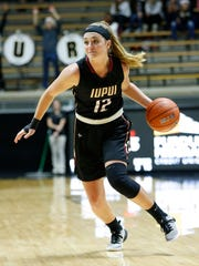 Catilyn Tolen of IUPUI brings the ball up court against