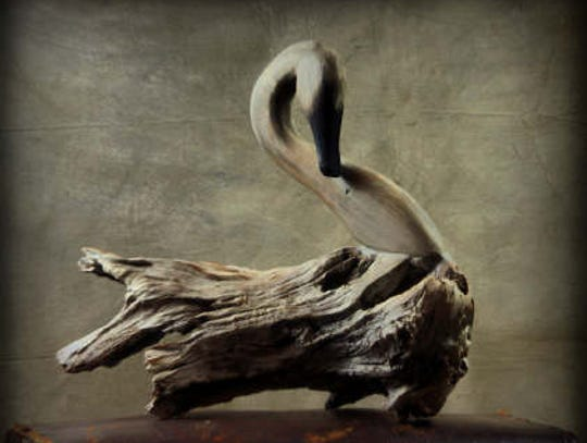 A wooden swan created by Chris Boone depicts the North