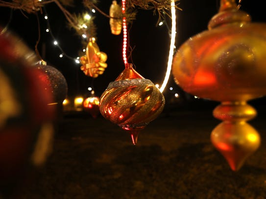 Ornaments hang on a tree at Minium Park in Aztec. The
