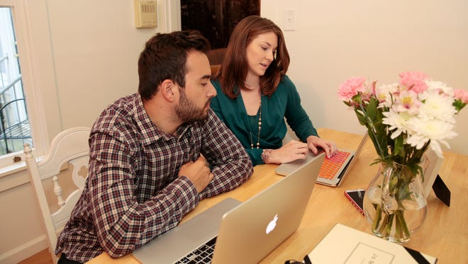 Jossi and Meg Cruz review their LearnVest financial information in their apartment in San Francisco.