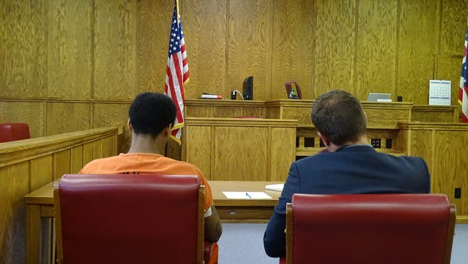 Royce Jewell, (left), was found delinquent - guilty, in adult court terms - on Tuesday of participating in the severe beating and robbery of a Tiffin man.   Jewell sits with his attorney, Matthew Exton.