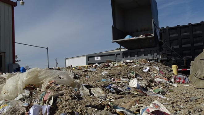 The Muskingum County Recycling Center collects raw materials to be compacted for easy shipment to Akron.