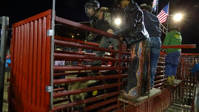 Dylan Thomas, 24, of Delaware, gets ready for his first bull ride at Coshocton County Fair on Saturday night.