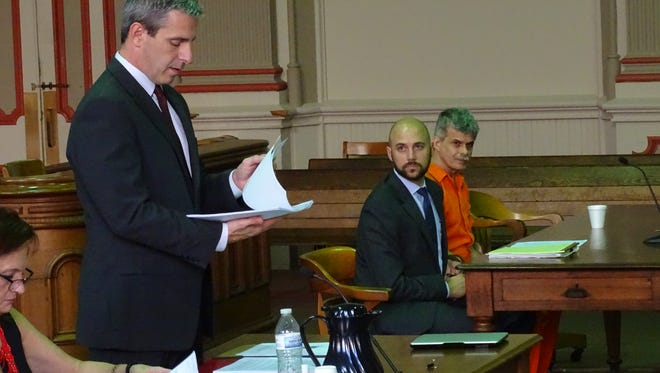 Assistant Prosecutor Ron Welch speak in common pleas court on Wednesday afternoon as Virgil Fleece and his attorney Marcus Van Wey listen. Fleeced pleaded guilty to 51 counts of pandering in obscenity involving a minor.