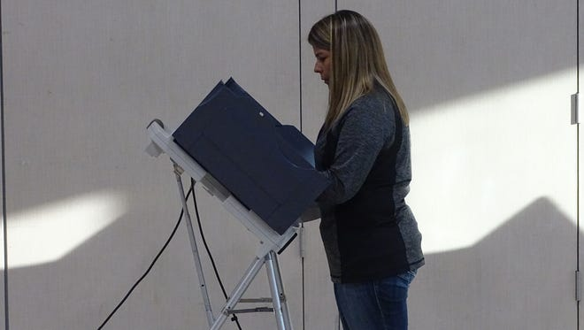 Jana Crist casts her vote Tuesday at the Career and Technology Education Centers of Licking County.