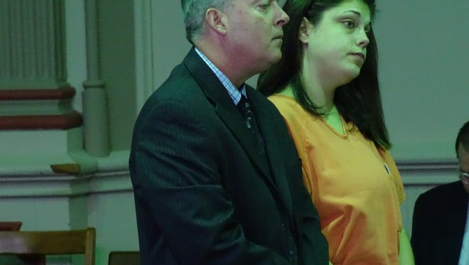 Heather Bowers, right, accompanied by her attorney Kort Gatterdam, left, listens to the judge after pleading guilty to a 2013 car crash that left one dead.