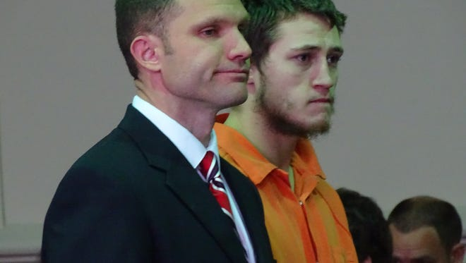 Brandon Fields, right, stands with his attorney Ben Whitacre in common pleas court on Wednesday. Fields pleaded not guilty to felonious assault. Prosecutors say he assaulted an inmate at the county jail.