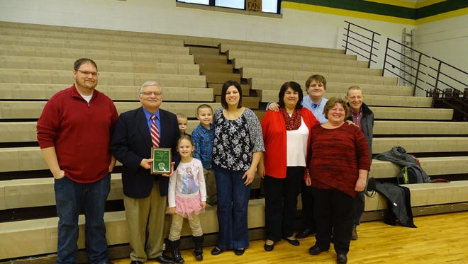 Steve Neal, second from left, was given the 2016 Distinguished Alumni award Friday morning at Bishop Flaget Catholic School.