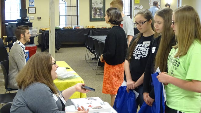 The Coshocton Campus of Central Ohio Technical College hosted its second annual Volunteer Youth Fair Wednesday to connect students with local community groups. From right, sisters Jenna, Megan and Lynsey Stonebraker, of Coshocton, learned about volunteer opportunities with the American Red Cross.