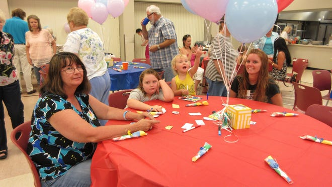 Sheryl DeFreece, left, came to The Compassionate Friends dinner and balloon release with her daughter-in-law, Shelby, right, and her granddaughters Lexy, 8, and Shyla, 2. DeFreece's son, J. DeFreece, died in 2010.