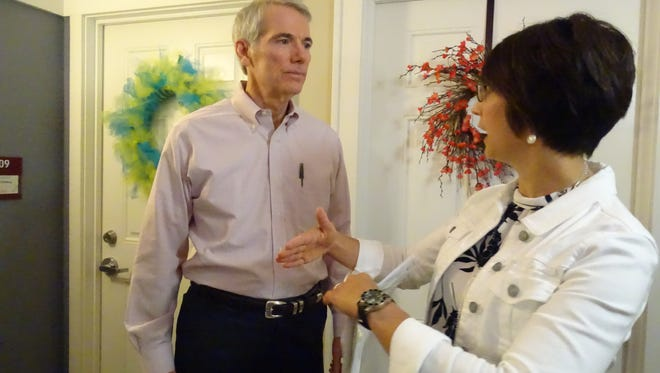 Sen. Rob Portman tours Pearl House with Jennifer Walters, president of Fairfield Homes on Aug. 4, 2016.