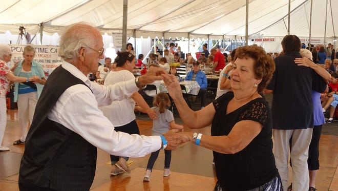Irene Hilpert, right, and Ted Harris danced to polka music at Port Clinton's Perch, Peach, Pierogi & Polka Festival. The Knights of Columbus sponsor the event.