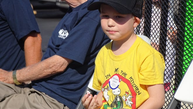 Michael Adkins, 6, of Gibsonburg gets ready to throw candy from a United Steelworkers parade trailer Monday at the annual Labor Day parade in downtown Fremont.