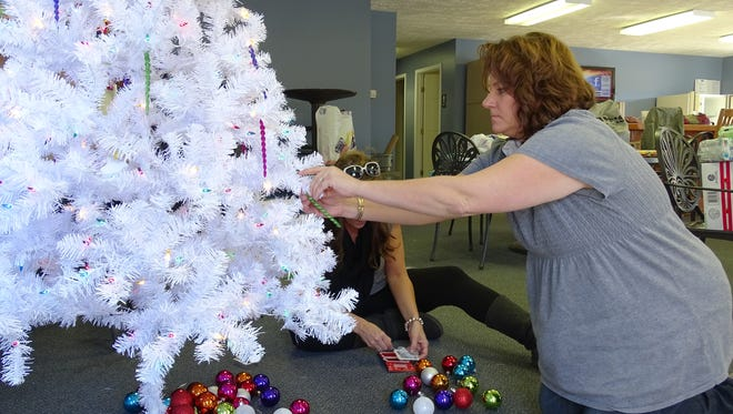 A Junior Civic League member prepares a Giving Tree for the group's annual Christmas Christmas Tree Gala.