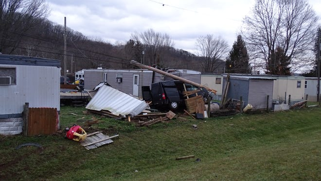 A van crashed into a mobile home Thursday morning off US 33A. The van knocked down power lines and landed on top of the home's fuel oil tank.