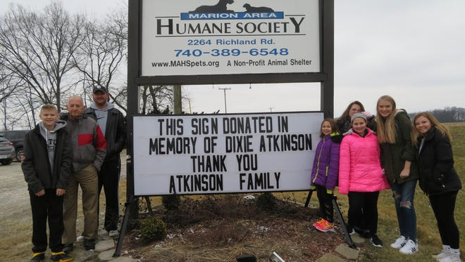 A sign dedication was held in memory of the late Dixie Atkinson, Saturday, Jan. 28 at the Marion Area Humane Society.  Pictured in the photo is Dixie's husband, Jim Atkinson and family members.  Rich and Deb Fulton (daughter) of Chelsea, Ala., who ordered the sign for the shelter, were unable to attend.