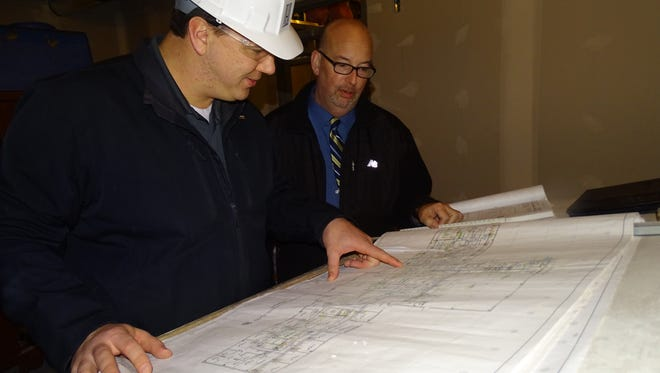 Project manager Ryan Bickley, of Janotta and Herner, shows designs to Community Health Services CEO Joe Liszak. The new CHS building on Hayes Avenue is scheduled to open in June.