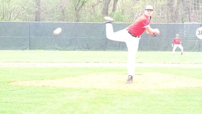 Ben Mikulik delivers a pitch during Monday's contest against Dover.