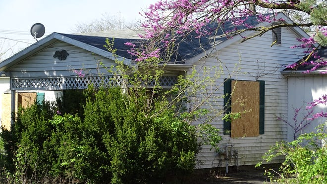 The home at 120 Cook St., deeded to the Sandusky County land bank, has been boarded up and will be demolished.