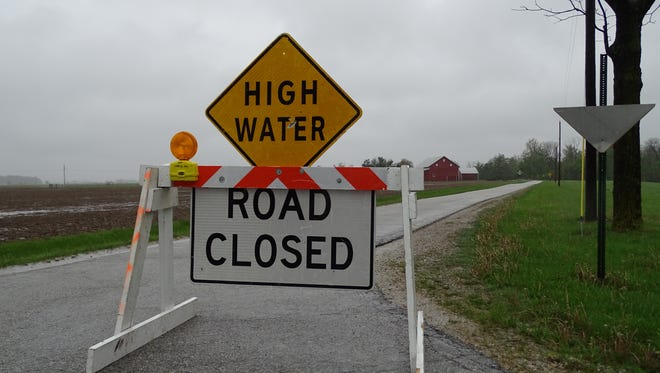 High waters caused by days of rain closed portions of North County Road 90 in Washington Township on Friday.