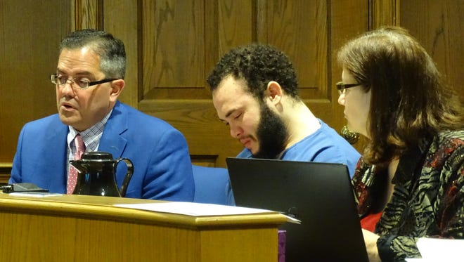 Marielkey Puello-Cruz, center, talks with interpreter Rafael Montanez, left, and defense attorney Kristin Burkett Tuesday in the Fairfield County Court of Common Pleas.