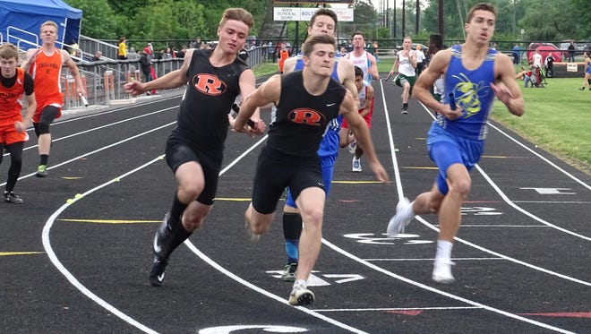 Ridgewood's Blake Craigo passes the baton to teammate Javon Merrill during the Inter-Valley Conference track meet. Ridgewood's 4x200 relay team competes in the state tournament this weekend.