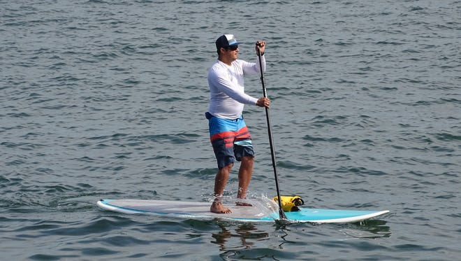 A man on a stand-up paddleboard enjoys the day on Lake Erie off the shores of Lakeside Chautauqua over the July 4 holiday.