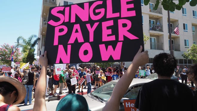 People rally in favor of single-payer healthcare for all Californians outside the office of California Assembly Speaker Anthony Rendon, June 27, 2017 in South Gate, California.