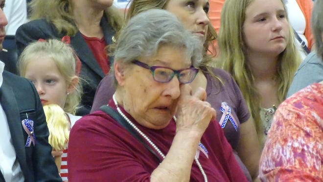 Ethel Smith, sister of John Kovach, wipes tears from her eyes Monday at a funeral service for the World War II veteran. Kovach died in 1942 and was buried with full military honors Monday at Riverview Cemetery. Prior to the burial, family and friends gathered at a funeral service at Bataan Elementary School in Port Clinton.