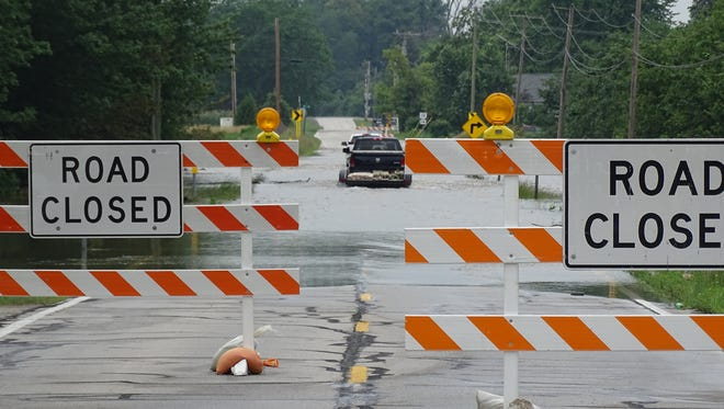 A pair of motorists ignored road closure signs and drove through high water Thursday on Ohio 19. The Ohio Department of Transportation announced the closure of Ohio 19 earlier in the day due to flooding.