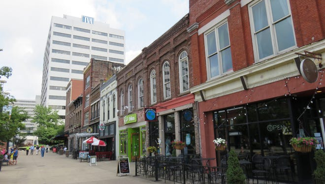 Historic storefronts along eastern side of Market Square, with TVA towers in the background.