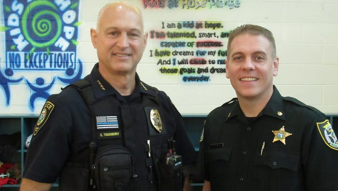 Chief Keith Touchberry, Chairman of Executive Roundtable with Eric Flowers of IRC Sheriff's Office.