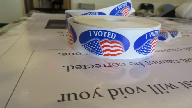 Poll workers at the Tompkins County Public Library gave voters stickers after voting in Tuesday's primaries.