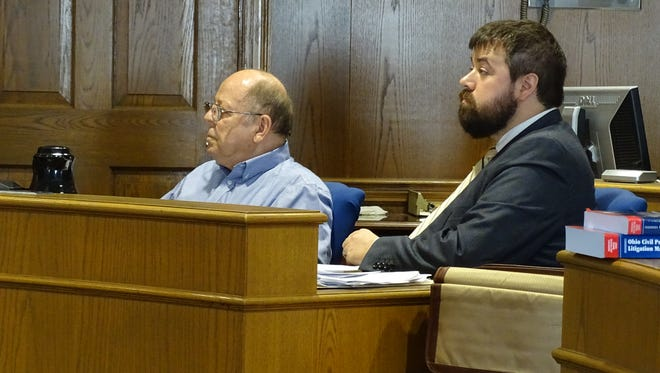 Jerry Ayers (left) and his defense counsel Donald Regensburger listen to Fairfield County Judge David Trimmer's ruling on Thursday, Sept. 21, 2017. Trimmer ruled that Ayers did not have the right to block a private access road owned by his family that connects to the village of Baltimore's property.